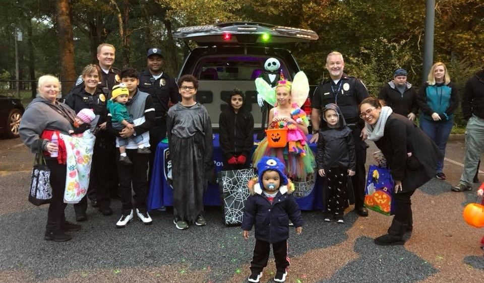 Police Officers and Families at Trunk or Treat Event