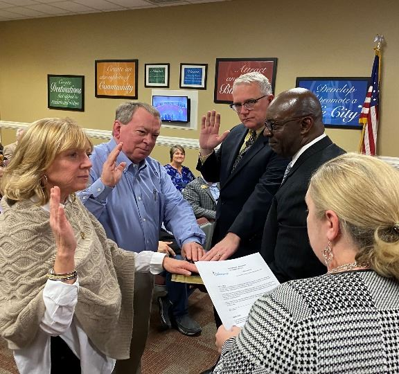 Kent Shelton, Sheila Marshal, and Ra Barr are sworn in as members of the Development Authority of Po