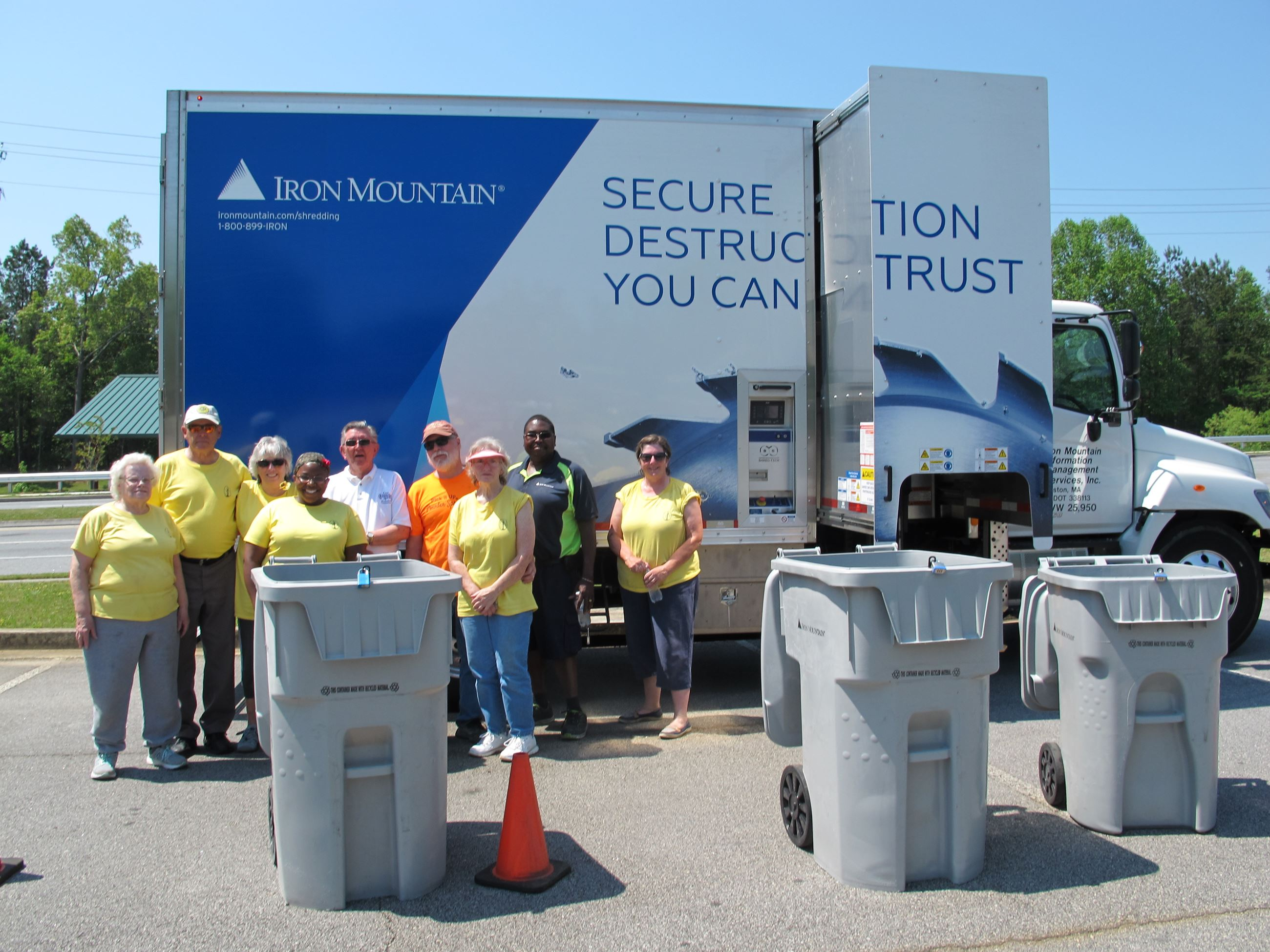 Volunteers at the paper shredding event with the shredding truck.